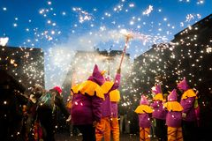 Traditional catalan correfocs celebration with fireworks and people dressed like demons in barcelona city center. Spain Royalty Free Stock Images