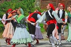 Traditional Catalan Dancers. EVOLENE, SWITZERLAND - AUGUST 14: Catalan dancers from Rubi in traditional costumes: August 14, 2017 in Evolene, Switzerland stock image