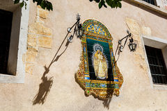 Traditional Catholic Altar in public street. Spain, Andalusia region, Sevilla. Traditional Catholic Altar in public street for prayer, 1957 stock photos