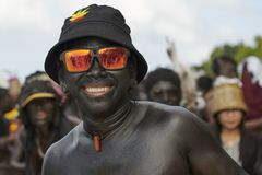 Participant of the Ati-Atihan parade on Boracay wearing sunglasses stock images