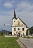 Traditional catholic church in Bohinjska Bela village near Bled, Slovenia. Royalty Free Stock Images