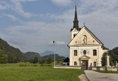 Traditional catholic church in Bohinjska Bela village near Bled, Slovenia. Stock Photography