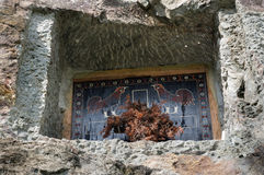 Traditional cave grave carved in the rock at Lemo. Tana Toraja, South Sulawesi, Indonesia royalty free stock images