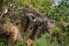 Traditional cave graves carved in the rock at Lemo. Tana Toraja, South Sulawesi, Indonesia Stock Photography