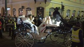 The traditional celebration of Saint Lucia before Christmas. HELSINKI, FINLAND - DECEMBER 13, 2016: Saint Lucia rides in the carriage around the city. The stock video footage