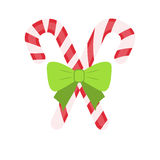 Traditional celebratory Christmas lollipops with. Green bow in flat style Stock Photography