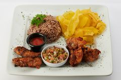 Traditional central american food. Gallo pinto and fries chicken stock photo
