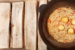 Traditional central asia pilaf in kazan Stock Images