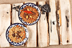 Traditional central asia pilaw in uzbek plate Royalty Free Stock Image