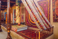 Traditional Central Asian embroidery. Traditional embroidery and interior in house of Central Asia Stock Images