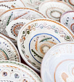 Traditional ceramic plates exposed to a fair Stock Images