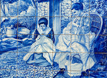 Traditional ceramic tiles in  Funchal on Madeira depicting local life. Stock Photography