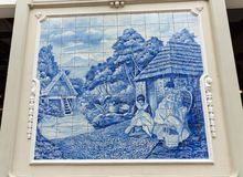 Traditional ceramic tiles in  Funchal on Madeira depicting local life Stock Images
