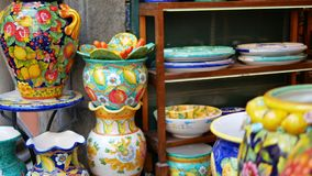 Traditional ceramics in the shop in Amalfi. AMALFI, CAMPANIA / ITALY - AUGUST 16, 2019: Traditional ceramics in the shop in Amalfi, Italy on August 16, 2019. Pan stock video footage