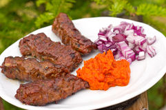 Traditional cevapcici with ajvar paste Royalty Free Stock Image