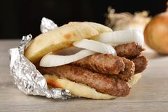 Traditional cevapcici in lepinja bread/Balkan food Royalty Free Stock Image
