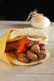 Traditional cevapcici in lepinja bread/Balkan food Royalty Free Stock Photo