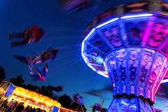 Traditional chain carousel at night Stock Photos