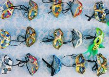 Traditional colorful decorated venetian masks for sale in Venice. Traditional cheap colorful venetian masks for sale in public market in Venice, Italy Stock Photo