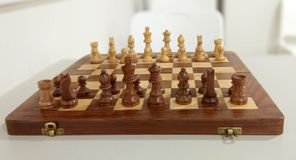 The traditional chess piece on chess board. stock images