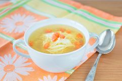 Traditional chicken broth with carrot. Royalty Free Stock Photography