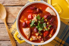 Traditional chicken chili stew with beans, corn and tomatoes clo. Se up in a pan. horizontal top view from above Royalty Free Stock Photos