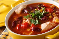 Traditional chicken chili stew with beans, corn and tomatoes clo. Se up in a pan. horizontal Stock Photos
