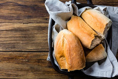 Traditional chilean bread marraqueta. On wooden background Stock Photo