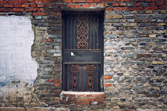 Traditional China residential door and brick wall Stock Image