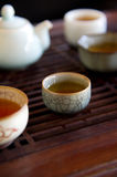 Traditional china tea and celadon cups on tabl Royalty Free Stock Images
