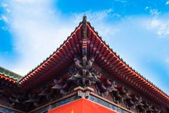 Beautiful ancient eaves. Traditional chinese architecture , colorful eaves ,red wall ,complex structure Royalty Free Stock Photos