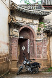 Traditional Chinese archway and motorcycle Stock Image