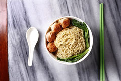 Traditional Chinese bowl of wanton noodle on the table Royalty Free Stock Photo