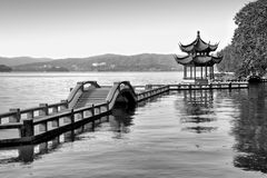 Traditional chinese bridge and pavilion on Hangzhou lake, China, Black and white. Traditional chinese bridge and pavilion on Hangzhou lake, China - Black and Stock Photography