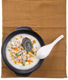 Traditional chinese century egg & pork porridge rice gruel serve Stock Image