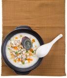 Traditional chinese century egg & pork porridge rice gruel serve. Porridge, century egg & pork Porridge (congee) served in claypot Stock Image