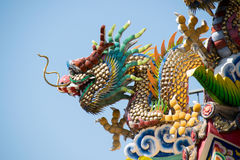 Traditional Chinese Ceramic Dragon sculpture on Roof Shrine stock images