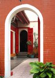 Traditional Chinese Courtyard. A Chinese temple with a courtyard and red doors Royalty Free Stock Photo