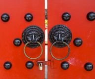 Traditional Chinese decorated with door knockers Royalty Free Stock Photo