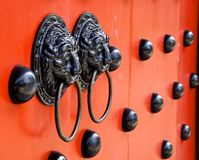 Traditional Chinese decorated with door knockers Stock Images