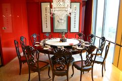 Traditional Chinese dinner table. With dedicate decorations in a restaurant in Shanghai. Carved wooden chairs or table are very popular in these Chinese style Royalty Free Stock Photo