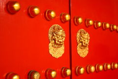 Traditional Chinese Door. Red chinese door with lion head knob Royalty Free Stock Photos