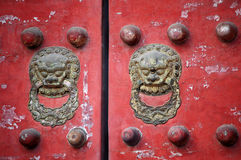 Traditional Chinese door. An old Chinese red door with lion head knob, taken at temple of heaven park Beijing China Royalty Free Stock Image