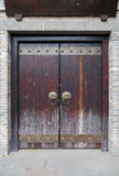 Traditional Chinese door with dragon doorknobs Royalty Free Stock Photos