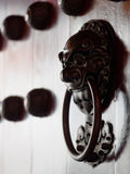 Traditional Chinese doors with brass handles symbolic of lion's heads Stock Image