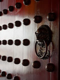 Traditional Chinese doors with brass handles symbolic of lion's heads Stock Photography