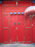 Traditional Chinese Doorway Red. A tradtional Chinese doorway in red with a red lantern Stock Photography