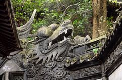 SHANGHAI, CHINA - May 6, 2017: Traditional Chinese dragon on old wall architecture in Yu Yuan Gardens, Shanghai, China. Stock Photography