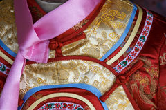 Traditional Chinese Dress. Close up of a dress in traditional Chinese style. The style is very detailed and red is a favourite colour stock photography