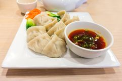 Traditional Chinese Dumpling With Dipping Sauce Royalty Free Stock Photos